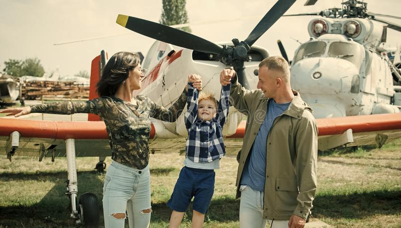Child Childhood Children Happiness Concept. Happy family spend time together, on excursion, helicopter or plane on. Background, sunny day royalty free stock photos