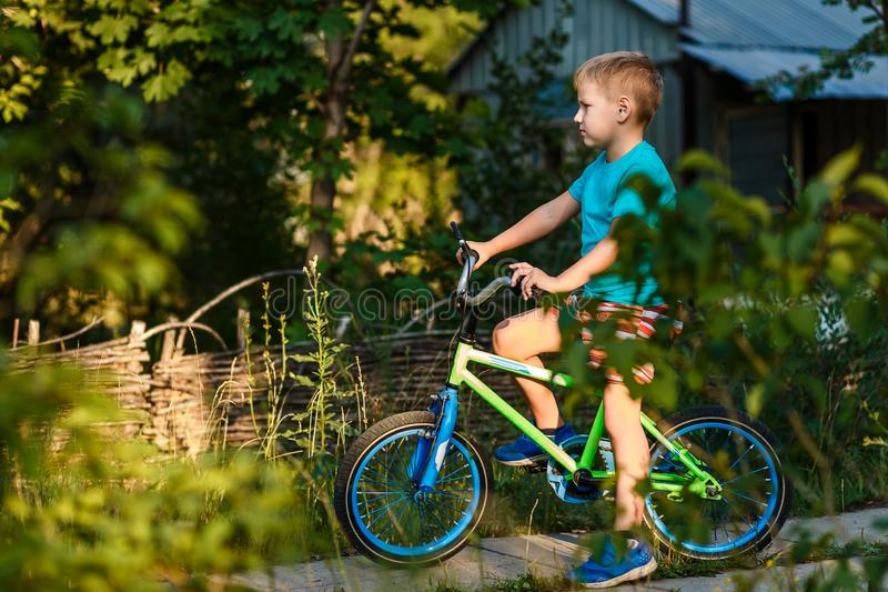 Child on a children`s bike stock image