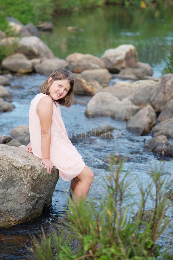 Child chilling in the river royalty free stock images