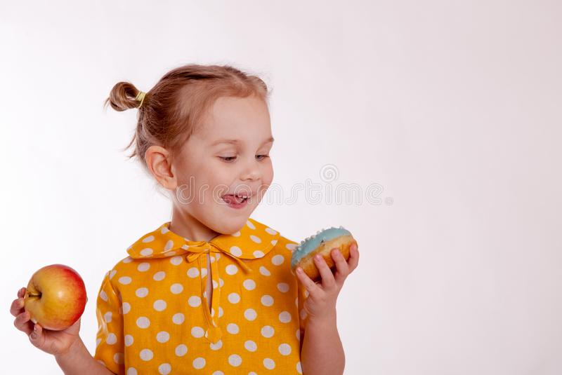 Child chooses to eat sweet or healthy stock image