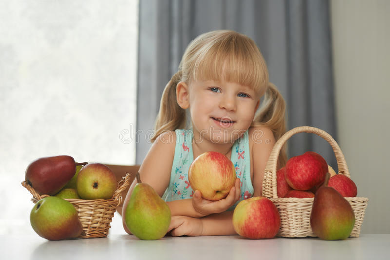 Child choosing a fresh apple to eat.  royalty free stock photography