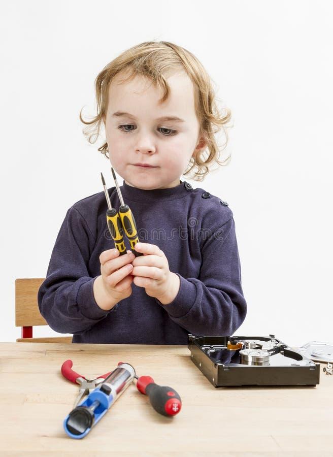 Child choosing tool for repairing hard drive royalty free stock image