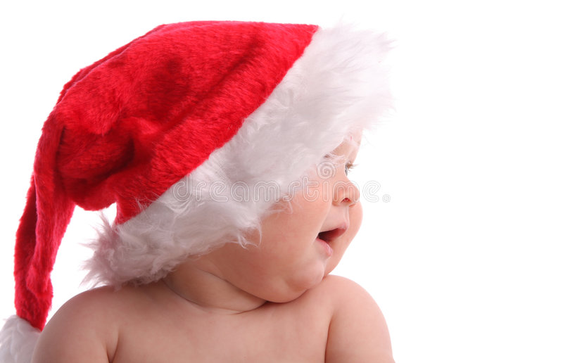 Child in a Christmas cap looking aside 3 stock photo