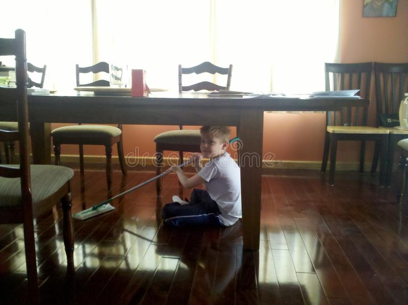 Child cleaning royalty free stock photography