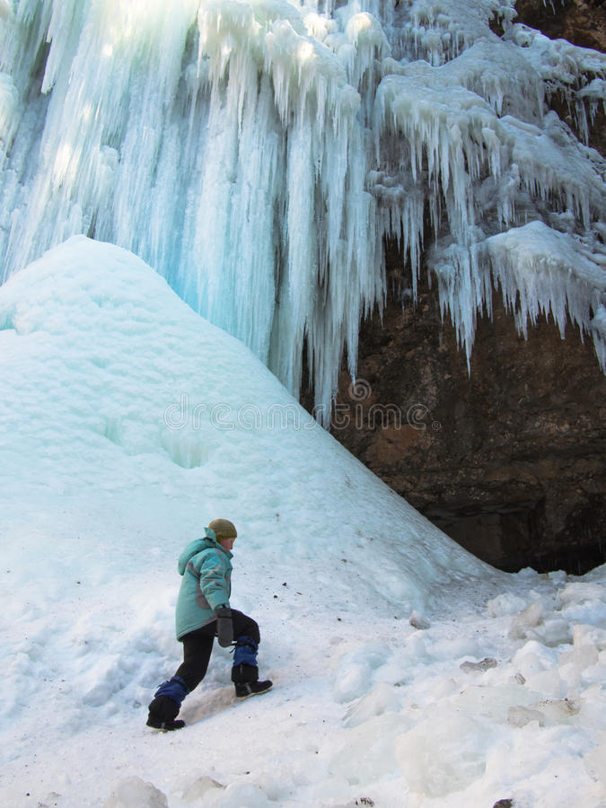 A child climbs on icy hill royalty free stock photos