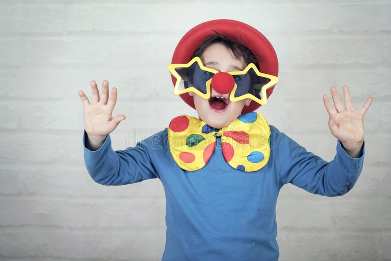 Child with clown nose and funny glasses royalty free stock photography