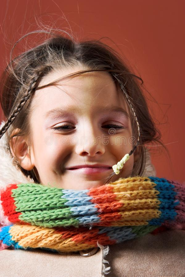 Child with coat and scarf royalty free stock images