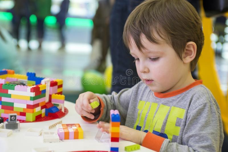 The child collects the Designer. Kids activity in kindergarten or at home.  stock image