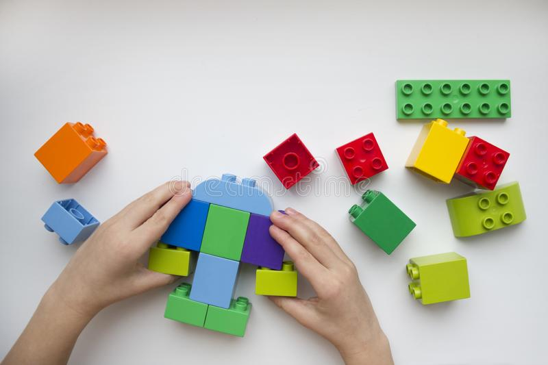 The hands of the child collector constructor. Educational toys for young children. royalty free stock photo