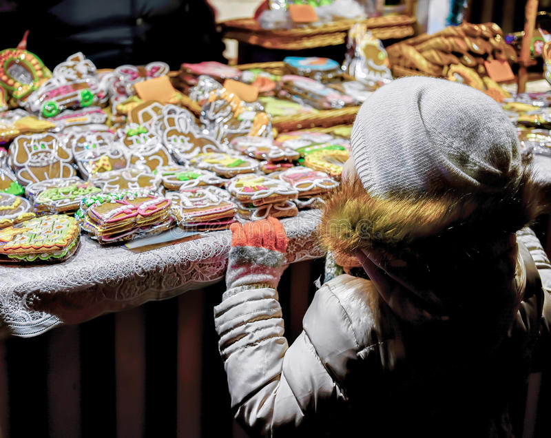 Child at Colorful gingerbreads at the Riga Christmas Market royalty free stock image