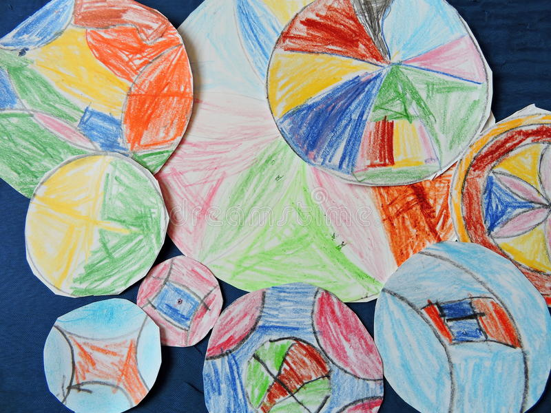 Child colorful painted mandalas. Child painted and cut mandalas, can use as background royalty free stock photo