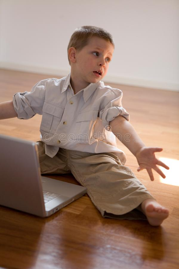 Child with computer royalty free stock photos