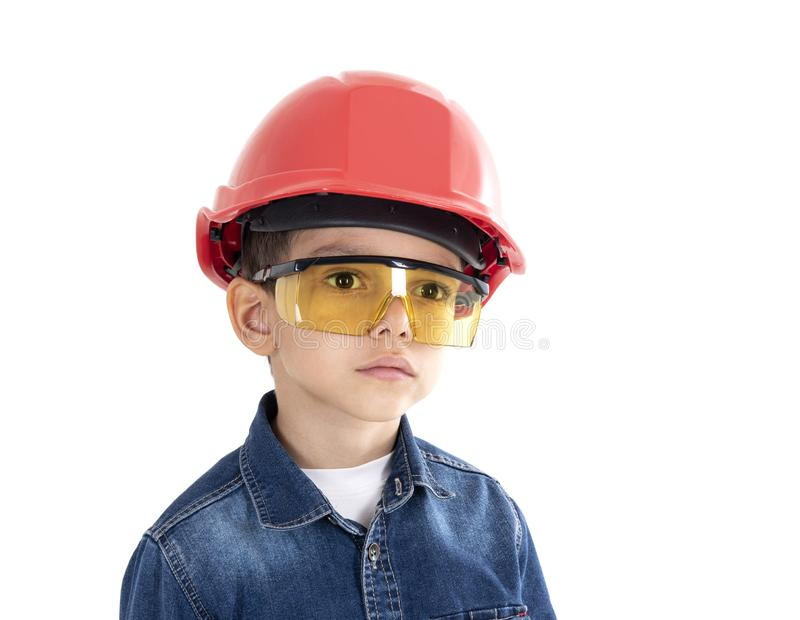 Child construction worker looking to the future. Isolated on white royalty free stock images