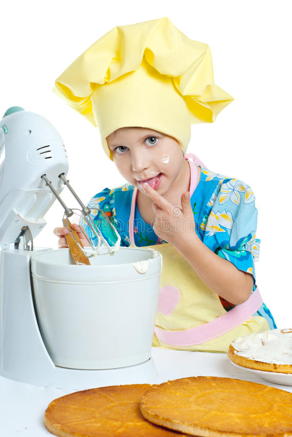 Child cook. The child help prepare the cook stock image