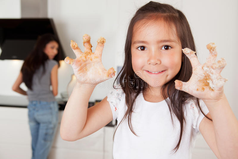 Child with Cookie Dough on Hands stock image