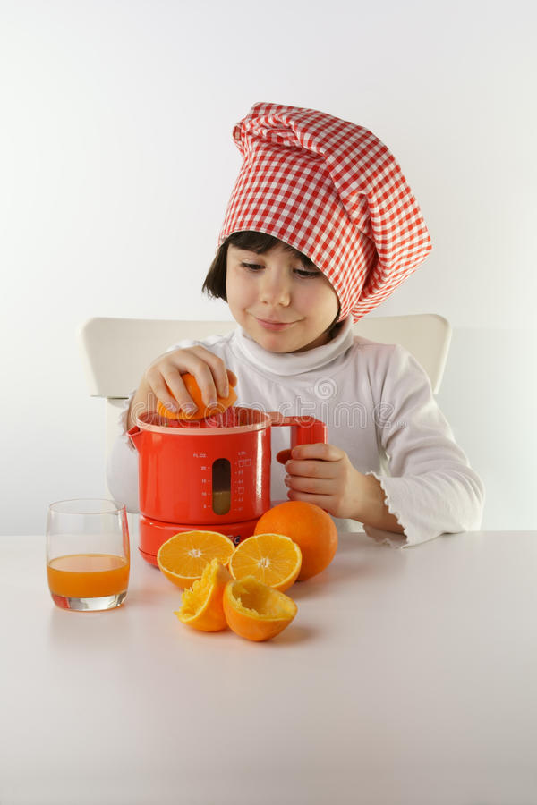 Child cooking juice royalty free stock photography