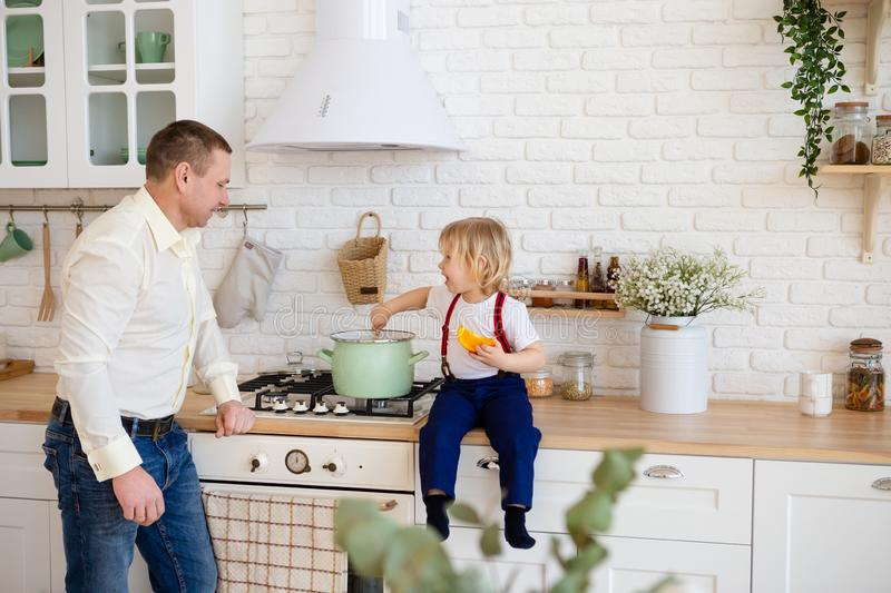 Child cooking in the kitchen with father stock photos