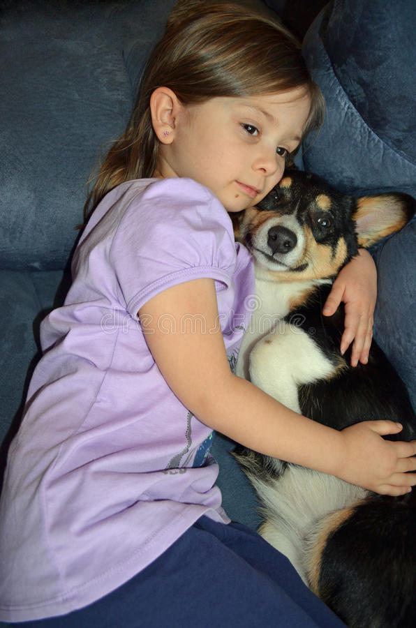 Download Child and a Corgi stock image. Image of cuddle, girl - 22833197
