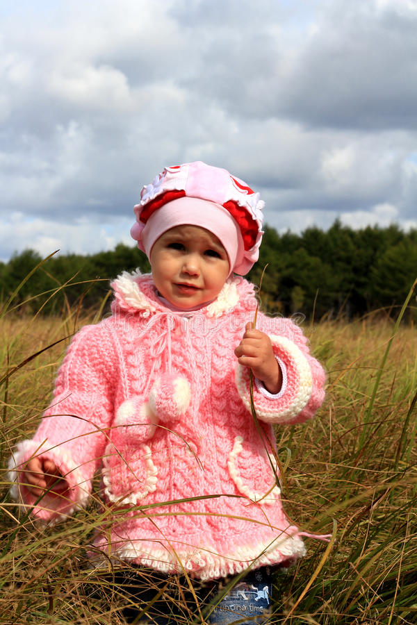 Download Child costs in a dry grass stock photo. Image of wood - 16345472