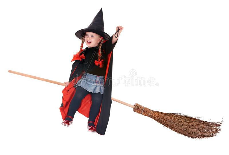 Child in costume Halloween witch fly on broom. Little girl in costume Halloween witch in black dress and hat fly on broom.Isolated royalty free stock photo