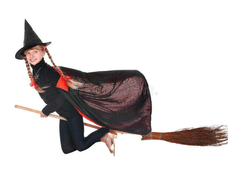Child in costume Halloween witch fly on broom. Little girl in costume Halloween witch in black dress and hat fly on broom.Isolated stock photo