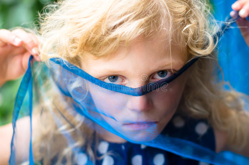 Child with covered face royalty free stock photos