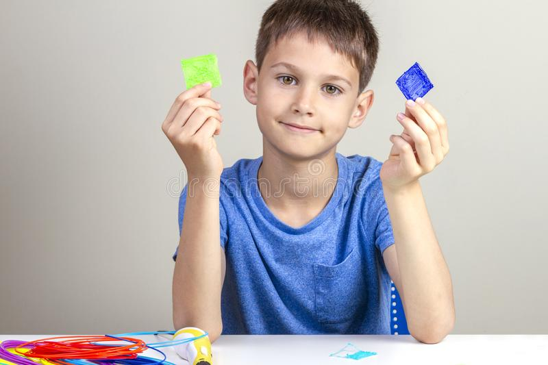 Child creating with 3d printing pen new object royalty free stock images