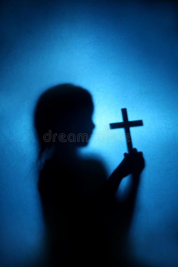 Child and cross stock photos