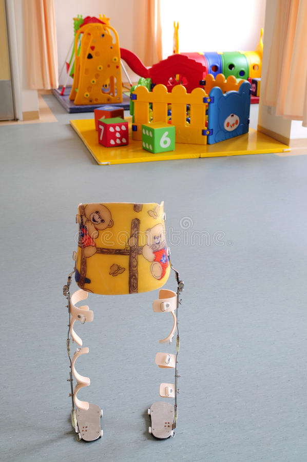 Child crutches at indoor playground royalty free stock images