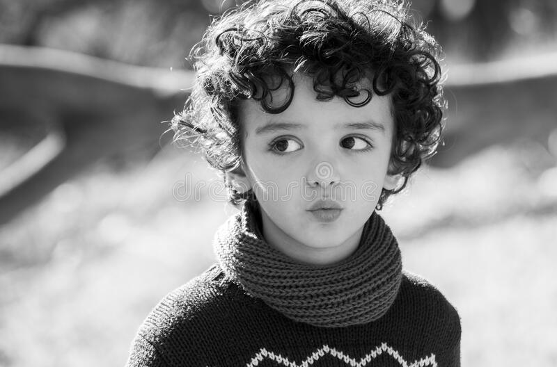 Child with curly hair royalty free stock image