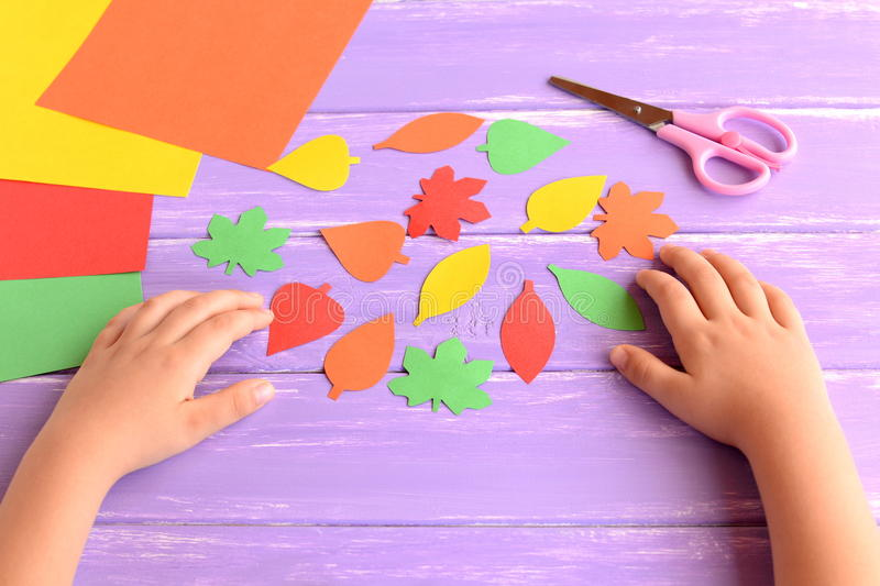 Download Child Cut Out Of Colored Paper Autumn Leaves Kid Doing Crafts