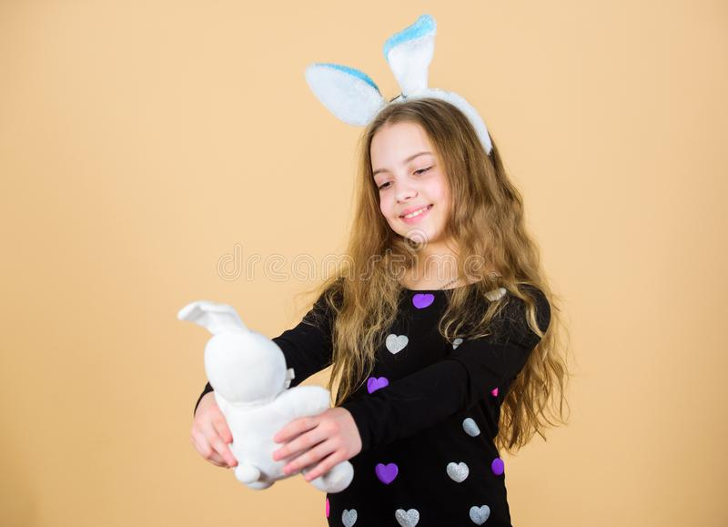 Child cute bunny costume. Kid hold tender soft rabbit toy. Easter day coming. Celebrate easter. Happy childhood. Easter royalty free stock images