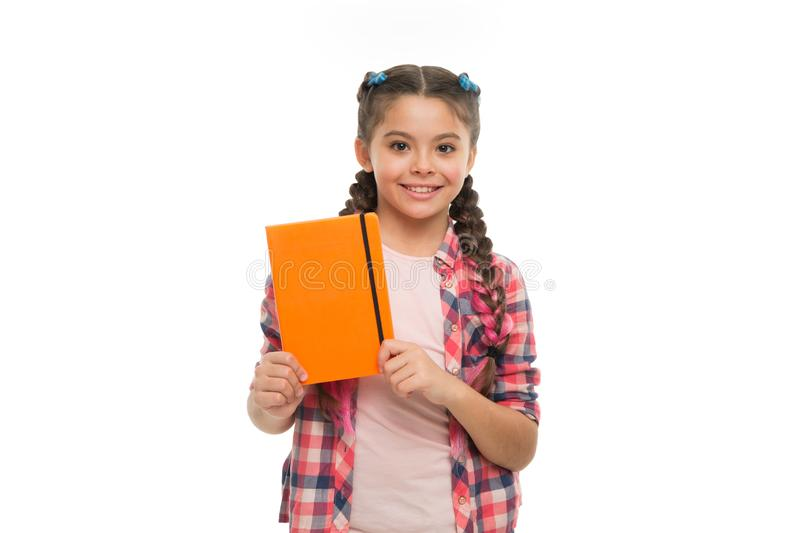 Child cute girl hold notepad or diary isolated on white background. Diary writing for children. Childhood memories royalty free stock photo