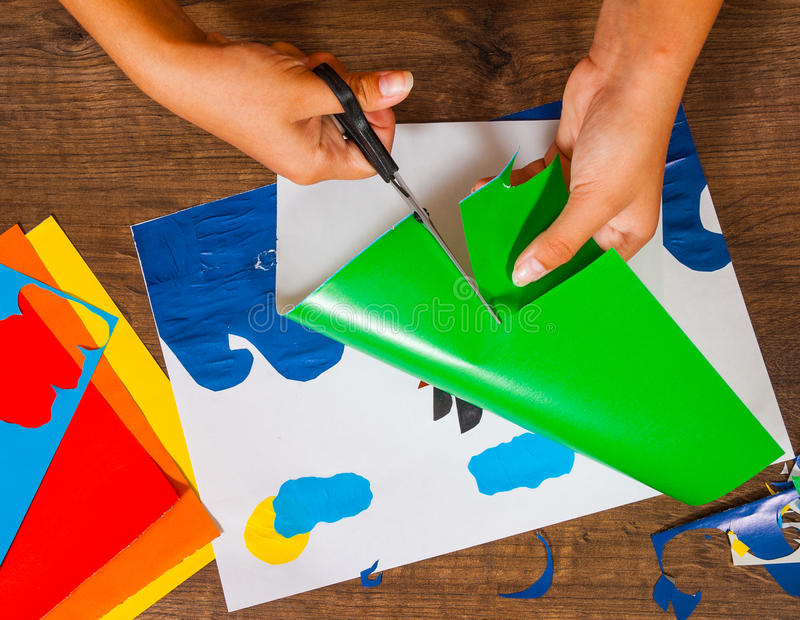 Kids art. Crafts concept. Handmade. on wooden table top view. Child cuts out of paper. Sheets of colored paper. Kids art. Crafts concept. Handmade. on wooden royalty free stock photography