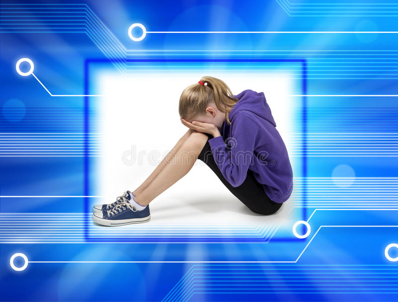 Child Cyber Bullying Computer. A young girl suffering pain from technology overload