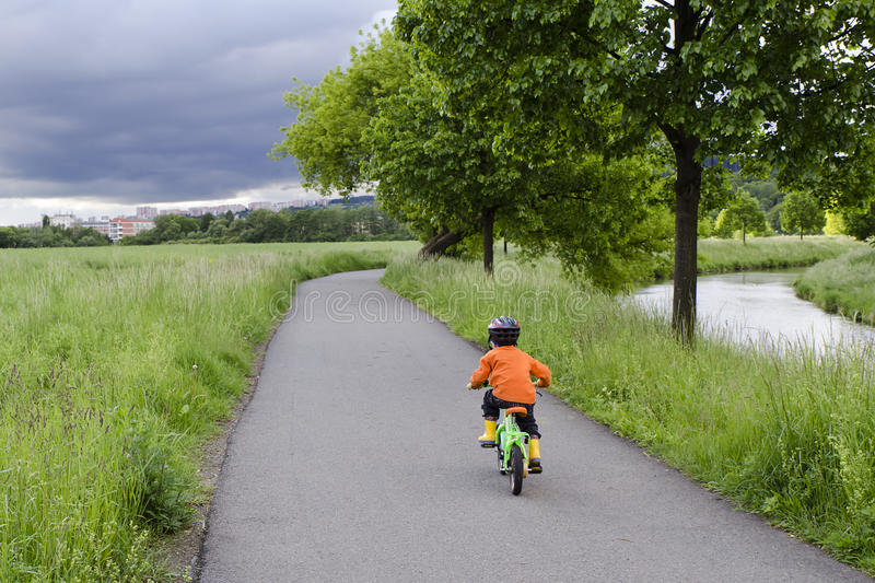 Child cycling stock photography