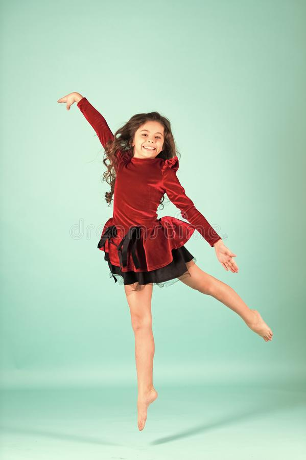 Child dance in red dress barefoot stock photos