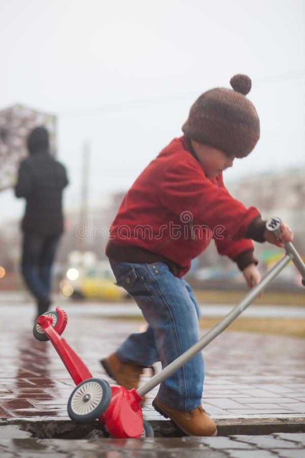 child danger on the road. pit on the royalty free stock photo