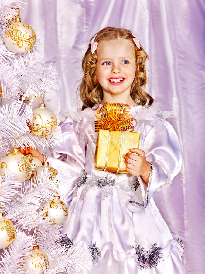 Child decorate white Christmas tree. royalty free stock images