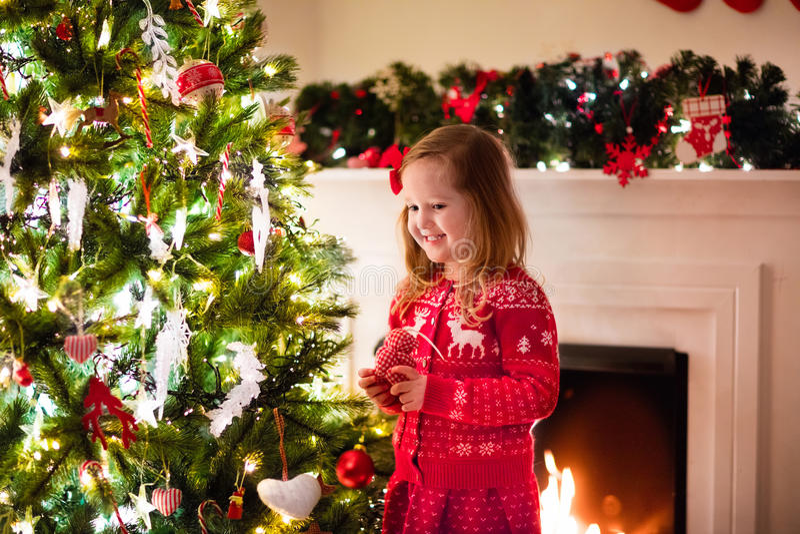 Child Decorating Christmas Tree Stock Image
