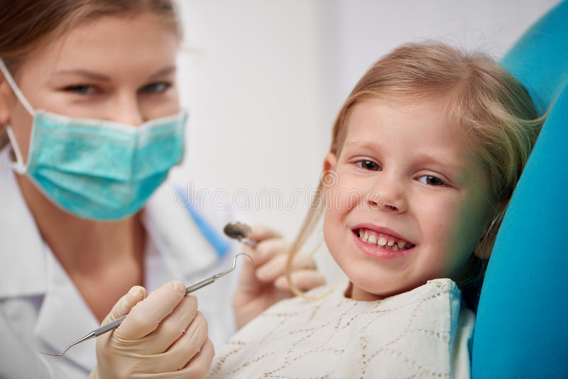 Child in dentist chair stock image