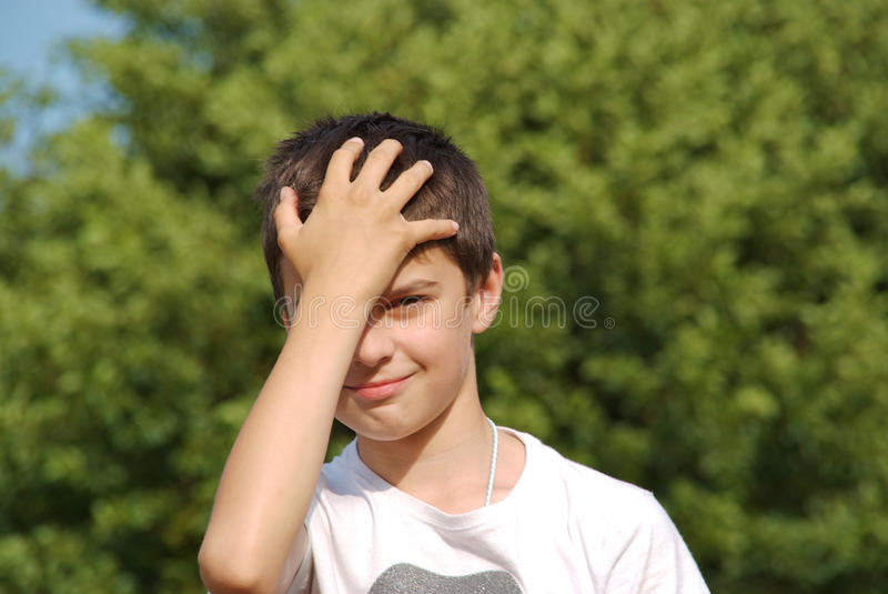 Download Child Did Something Stupid, Hand To Forehead Stock Photo - Image: 10681214