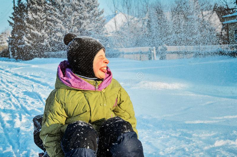 A child with the disease cerebral palsy walking in the winter. Closeup portrait. Happy and joyful boy smiling royalty free stock images
