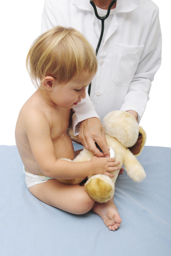 Download Child And Doctor Examining A Teddy-bear Stock Photo - Image of doctor, diagnostic: 11714212