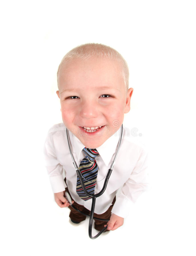 Child Doctor Smiling With Stethoscope royalty free stock photos