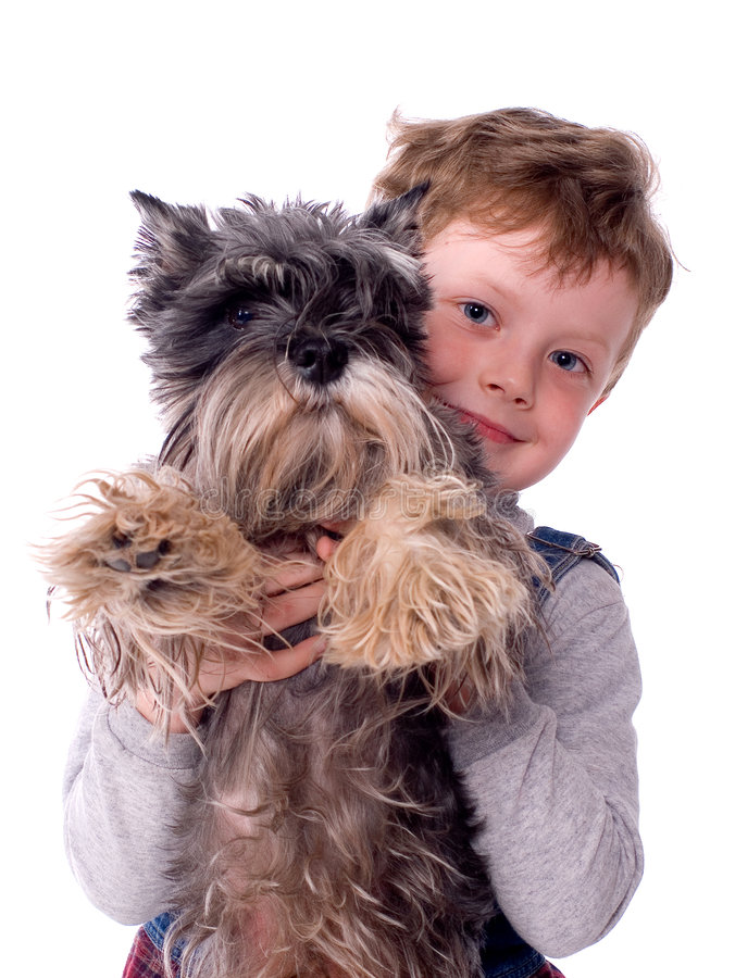 The child with a dog. The child sits with a dog on a white background