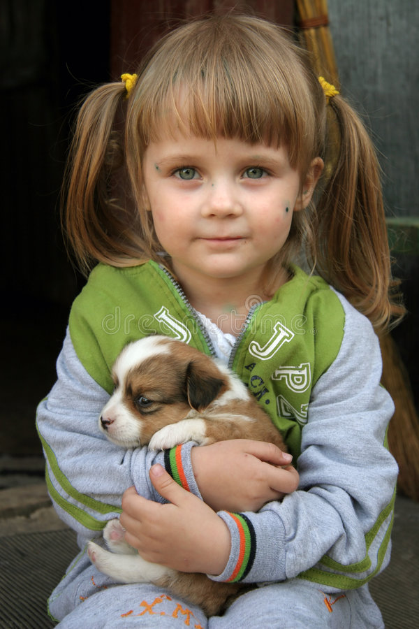 Child and dog. Young girl with her dog
