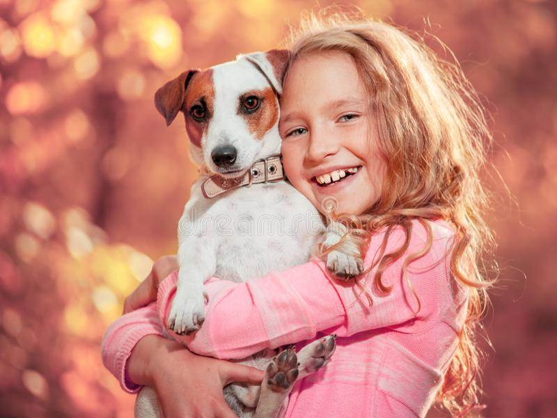 Child with dog at autumn royalty free stock photos