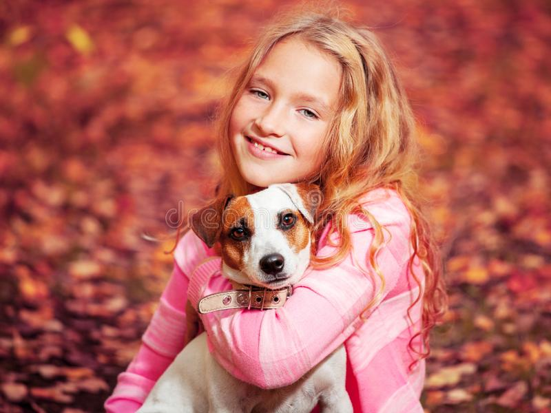 Child with dog at autumn stock photos