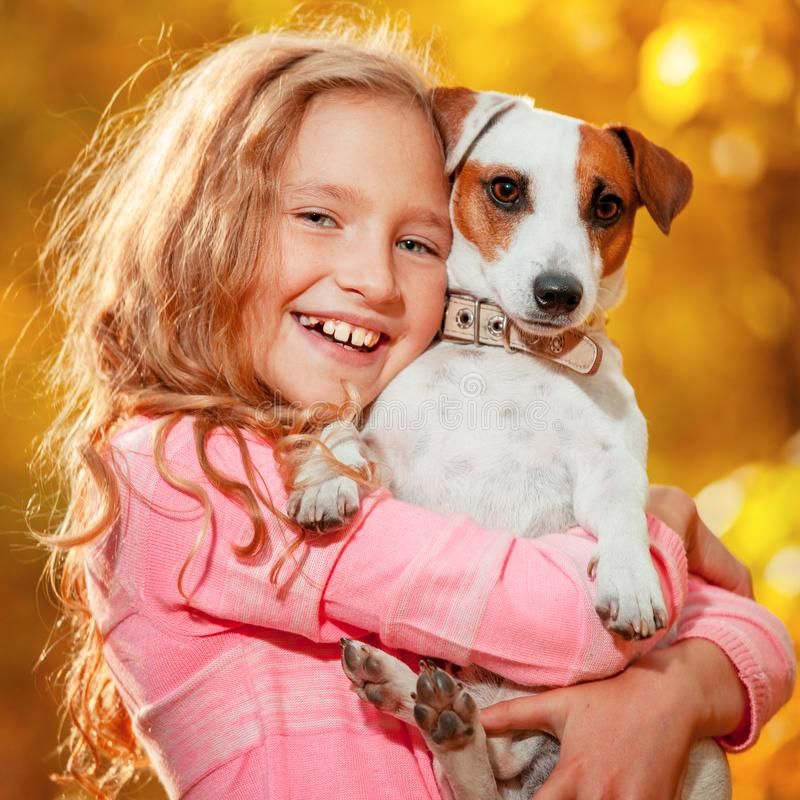 Child with dog at autumn stock image